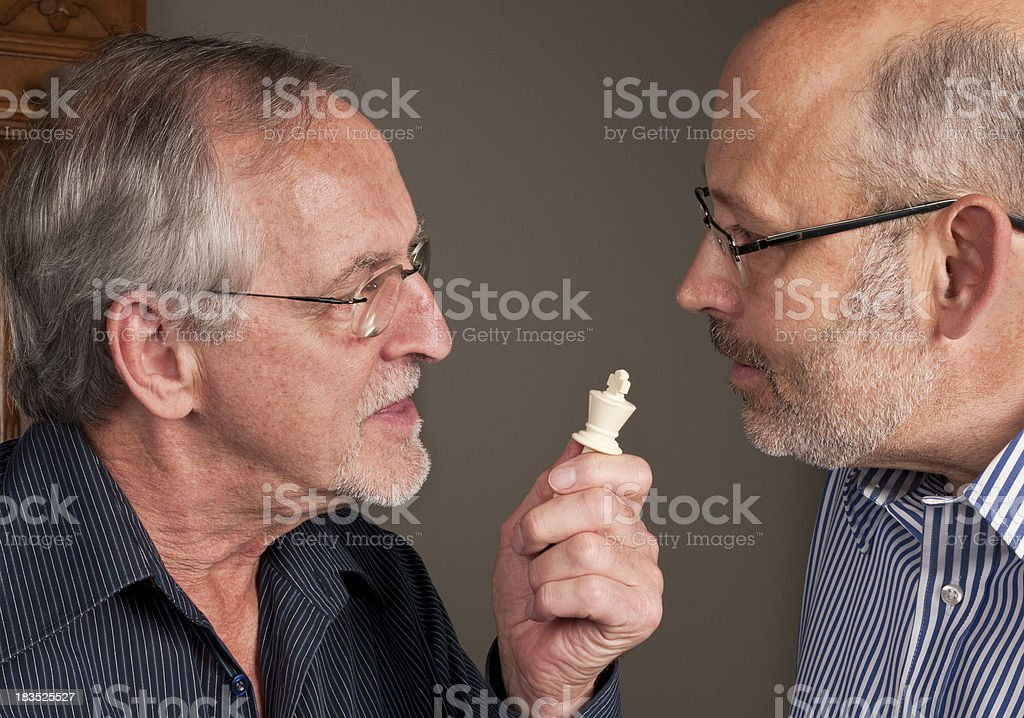 Two men arguing over a chess game stock photo