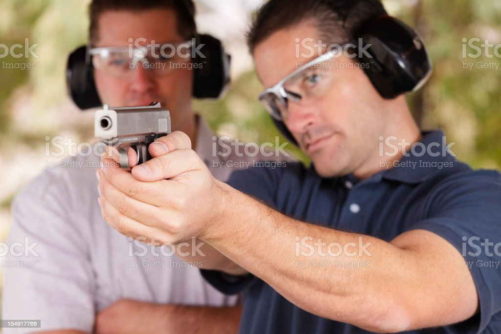 Two Men at the Shooting Range royalty-free stock photo