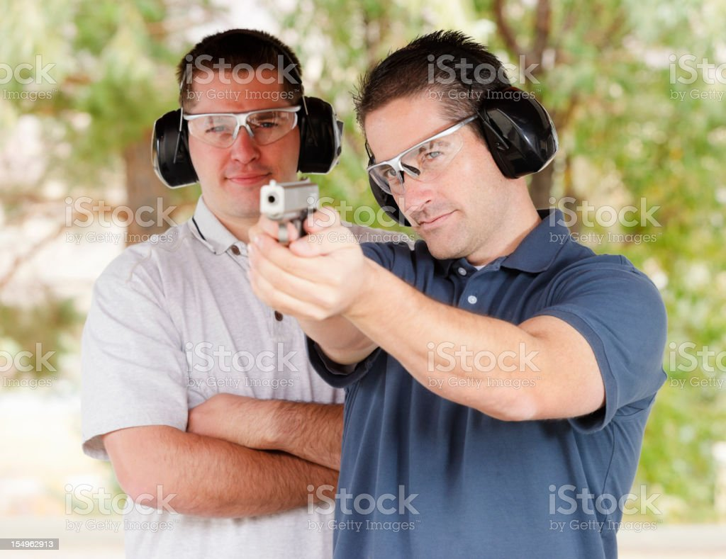 Two Men at the Shooting Range stock photo