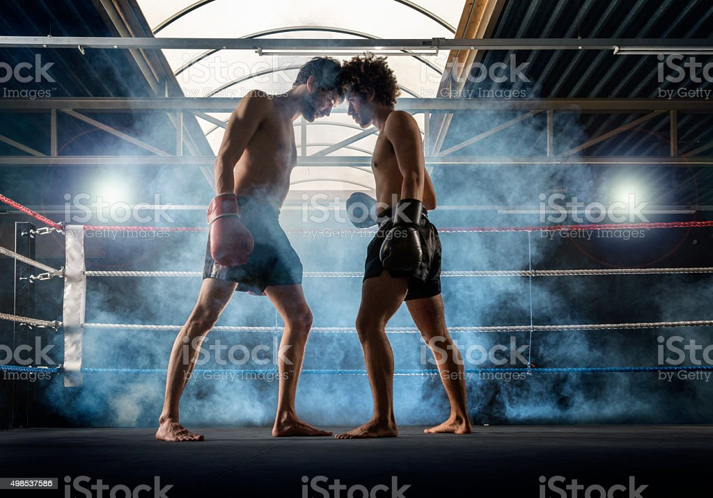 Two men at the start  of Thai boxing stock photo