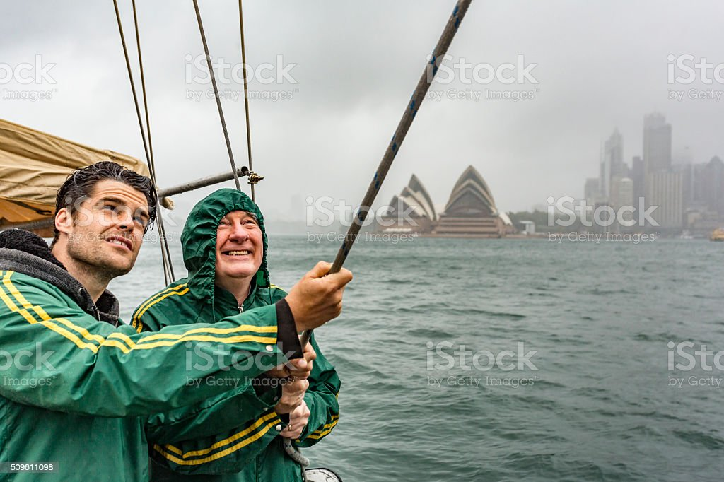Two Men Battling a Storm on a Yacht in Sydney stock photo