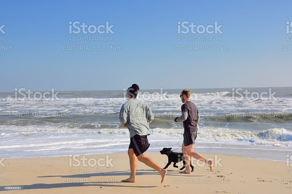Two Men Beach Running In Winter royalty-free stock photo
