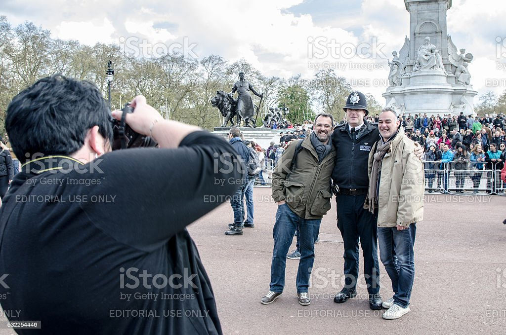 Two men being taken in picture with policeman stock photo