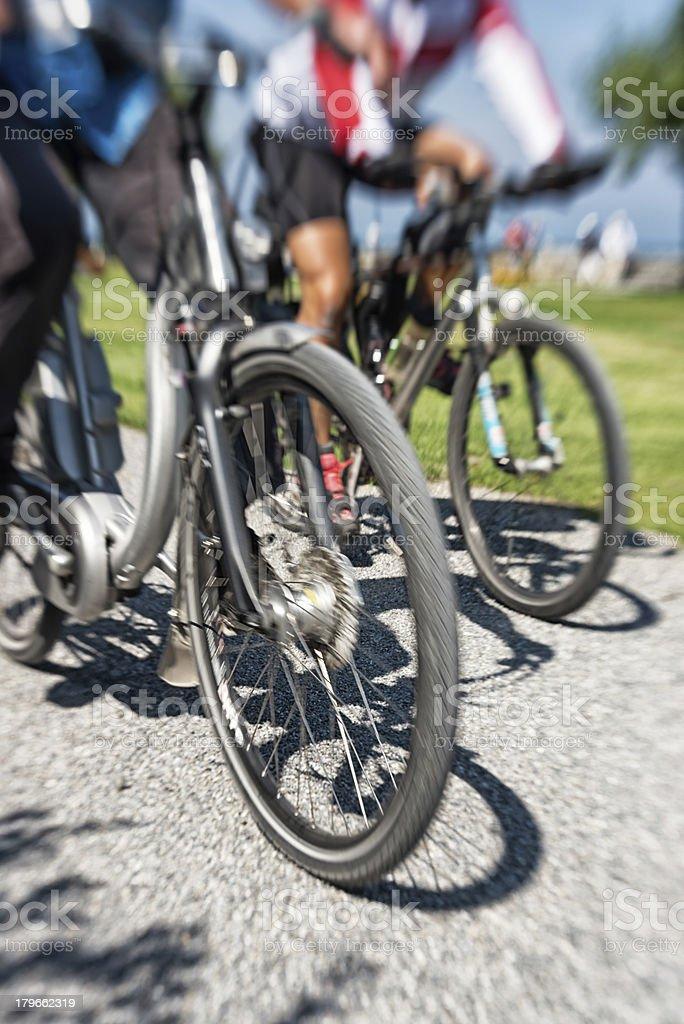 two men bicycling on cravel lane. stock photo