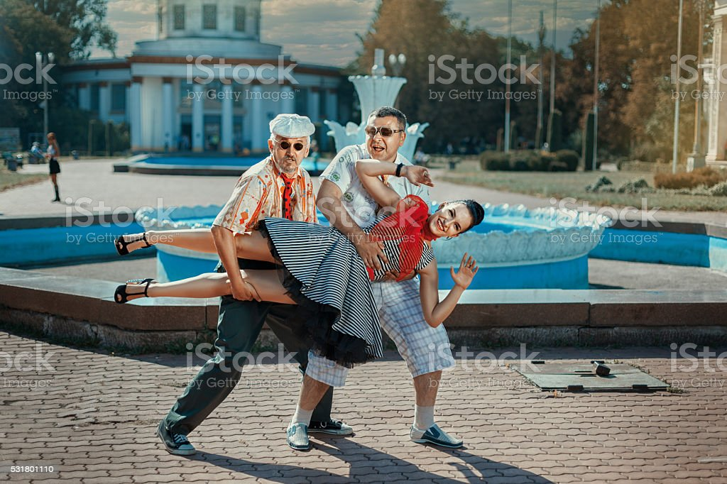 Two men carried a woman. stock photo