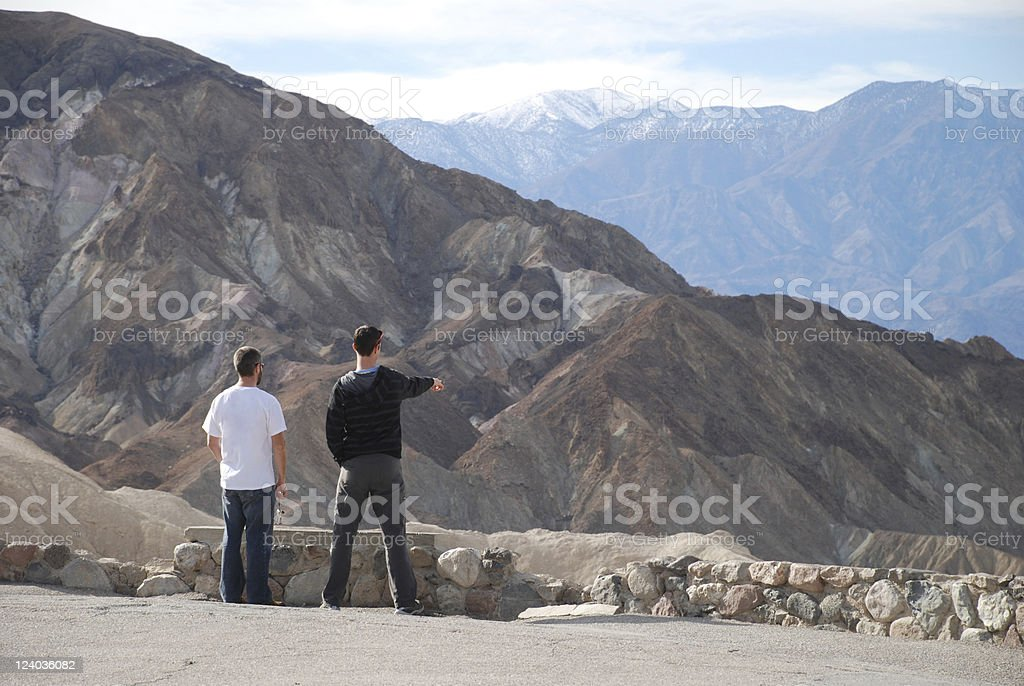 Two Men Checking out a Mountain View royalty-free stock photo