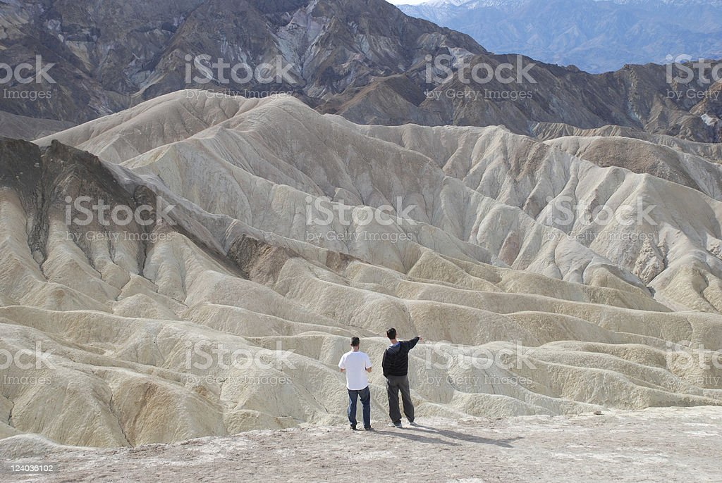 Two Men Checking out an Expansive Mountain View royalty-free stock photo