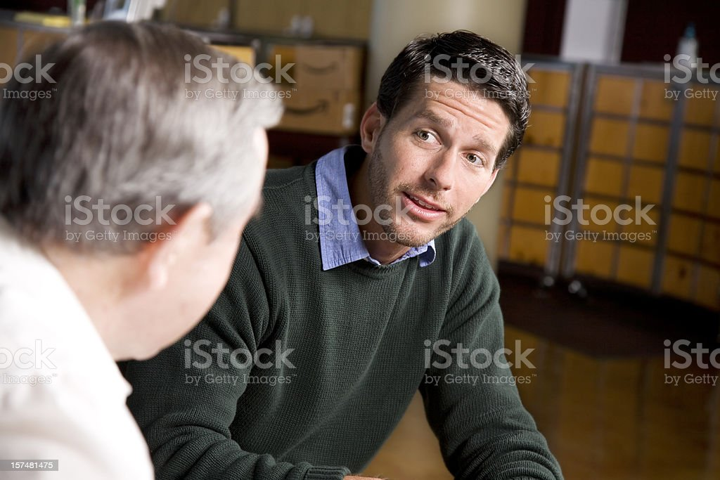 Two Men Conversing Together At A Church royalty-free stock photo