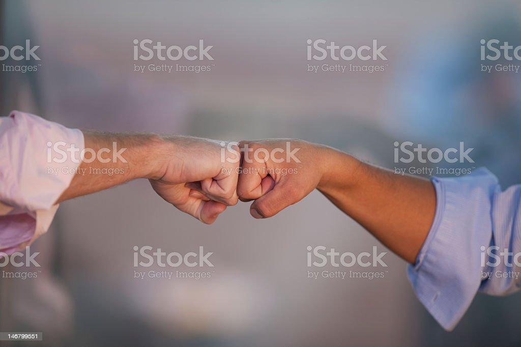 Two Men Doing Fist Bump (Modern Handshake) stock photo