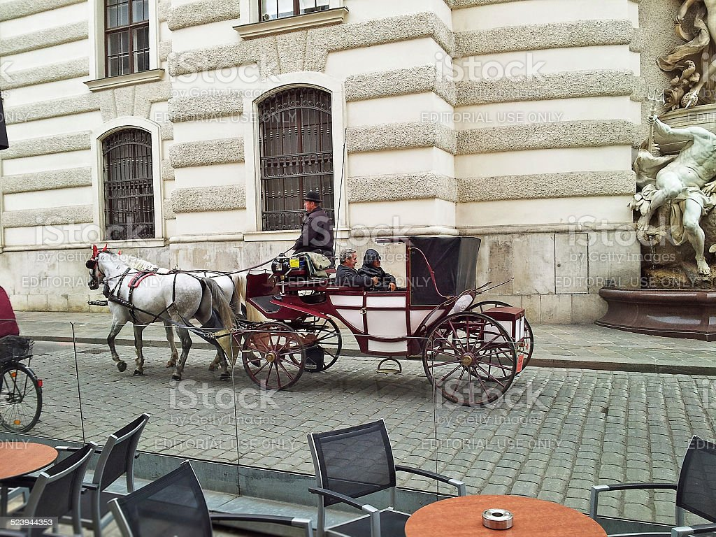 Two men enjoy a trip on Vienna's fiacre stock photo