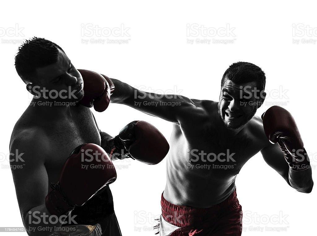 two men exercising thai boxing silhouette royalty-free stock photo