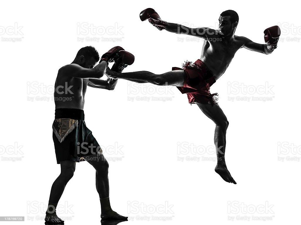 two men exercising thai boxing silhouette stock photo