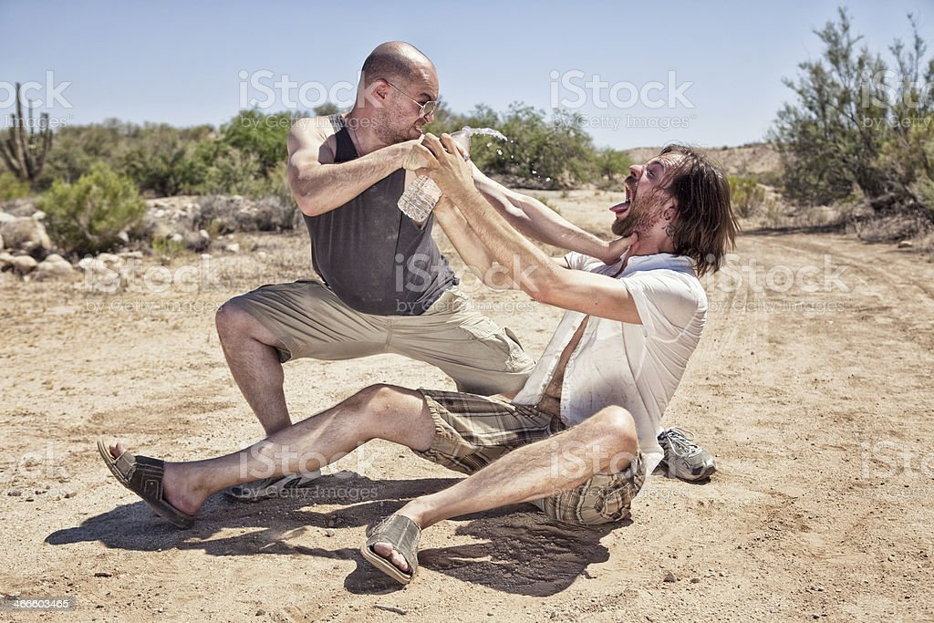 Two Men Fighting Over Water stock photo