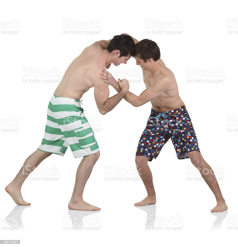 Two men fighting royalty-free stock photo