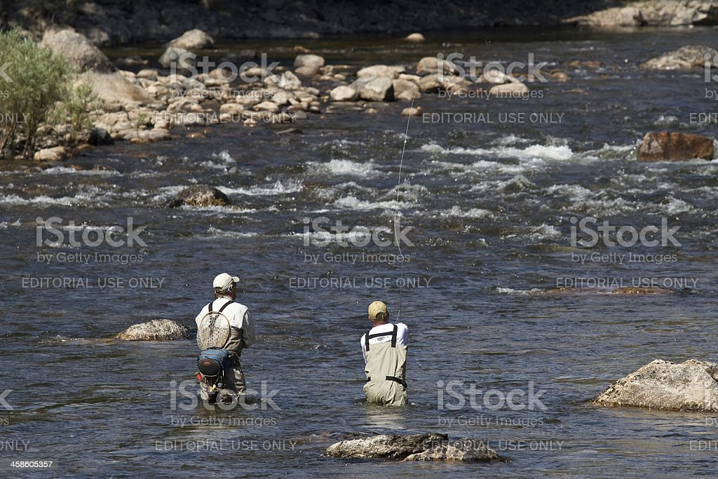 Two Men Fly Fishing in a Mountain River royalty-free stock photo