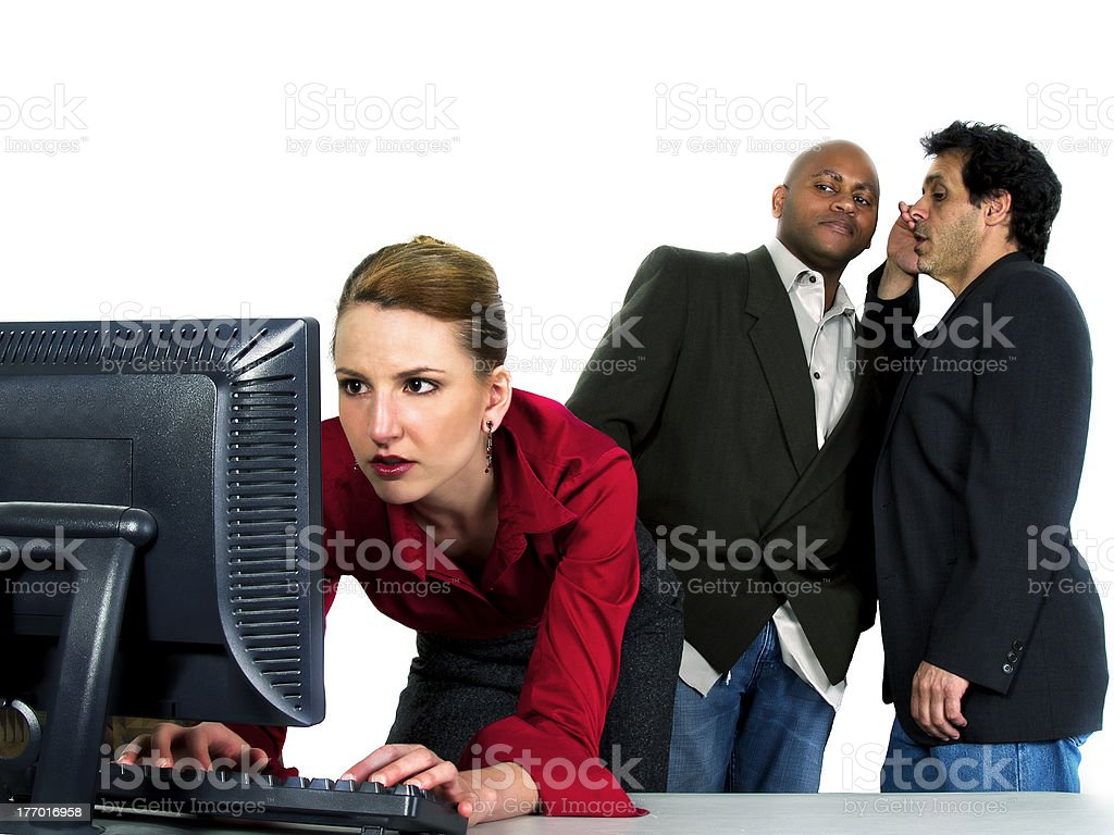Two Men Gossiping About a Female Co-Worker stock photo