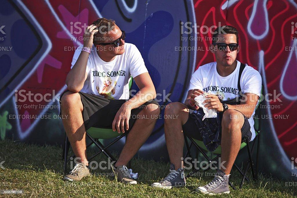 Two men having a break during Roskilde Music-Festival, Denmark stock photo