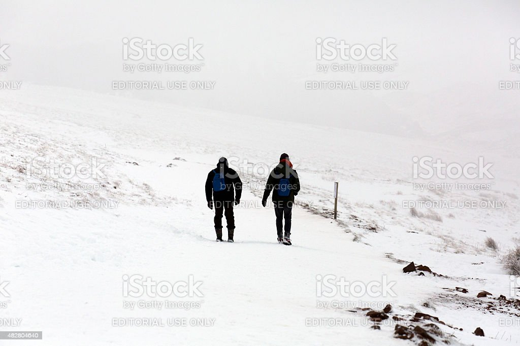 Two Men Hiking in the Snow stock photo