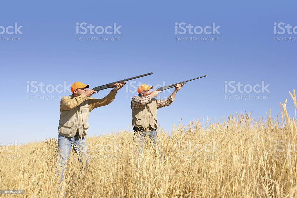 two men hunting stock photo