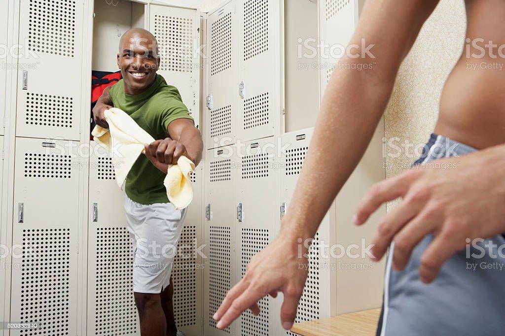Two men in a locker room stock photo