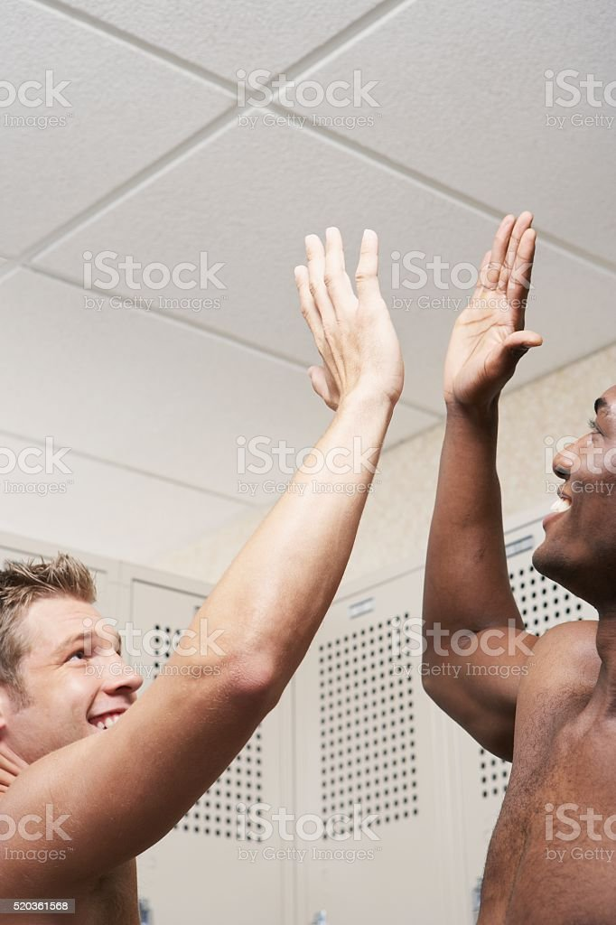 Two men in a locker room stock photo