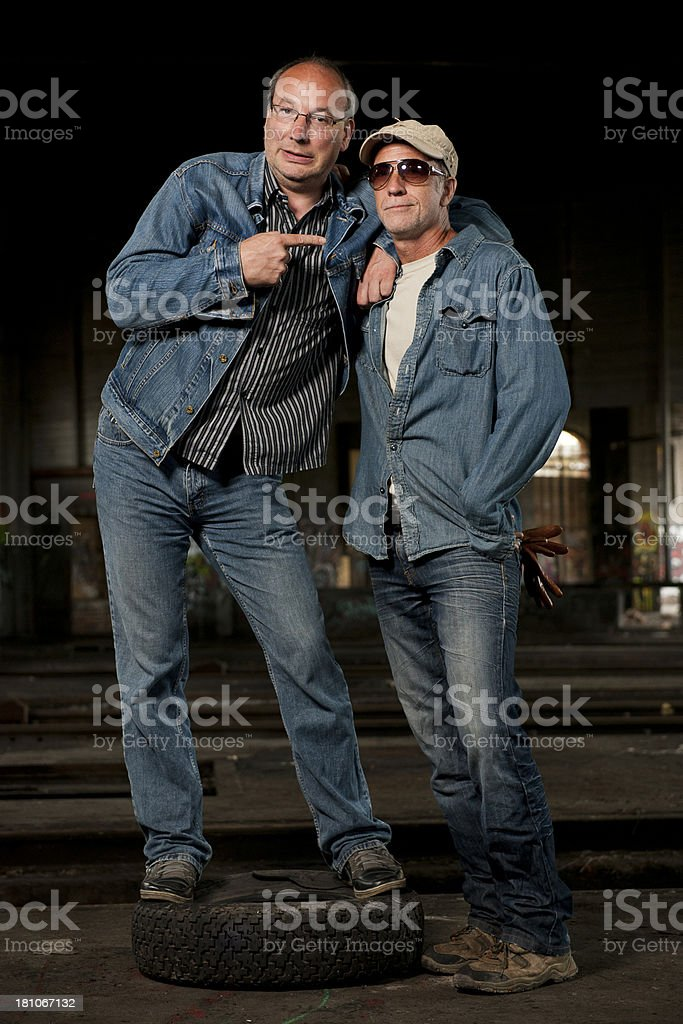 Two men in abondoned factory royalty-free stock photo