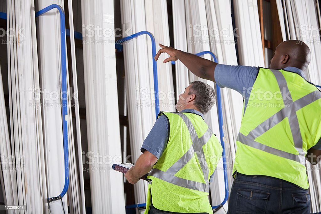Two men in building supply store stock photo