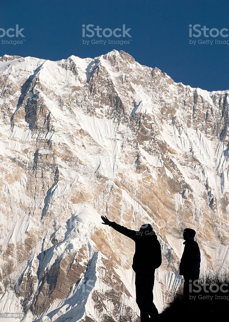 Two men in front of the mighty Himalayan Annapurna Mountain royalty-free stock photo