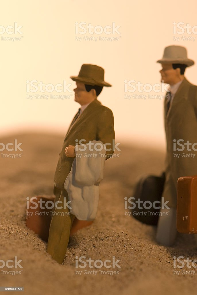 Two Men in Quicksand stock photo