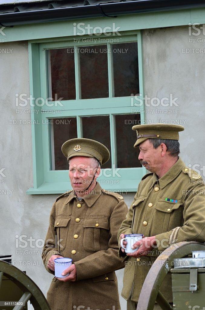 Two men in World war one uniform enjoying cup  tea stock photo