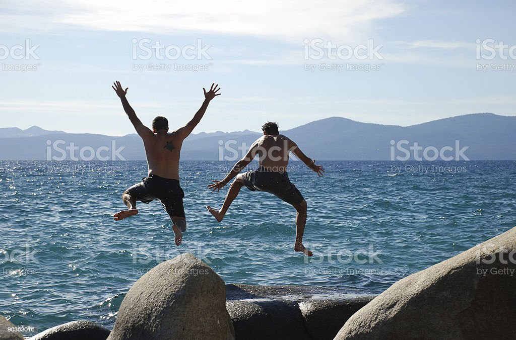 Two men jumping royalty-free stock photo