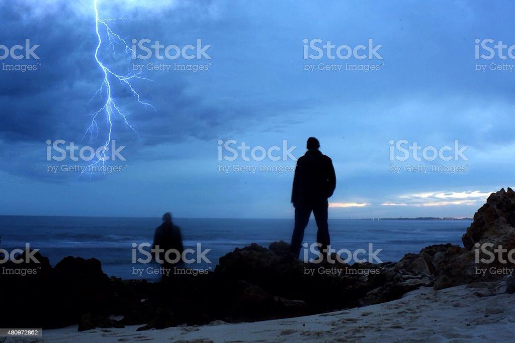 two men lightning stock photo