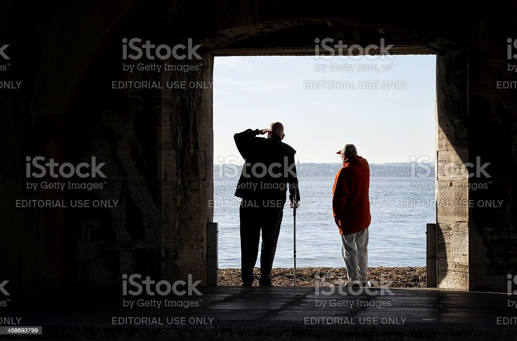 Two men looking out to sea royalty-free stock photo