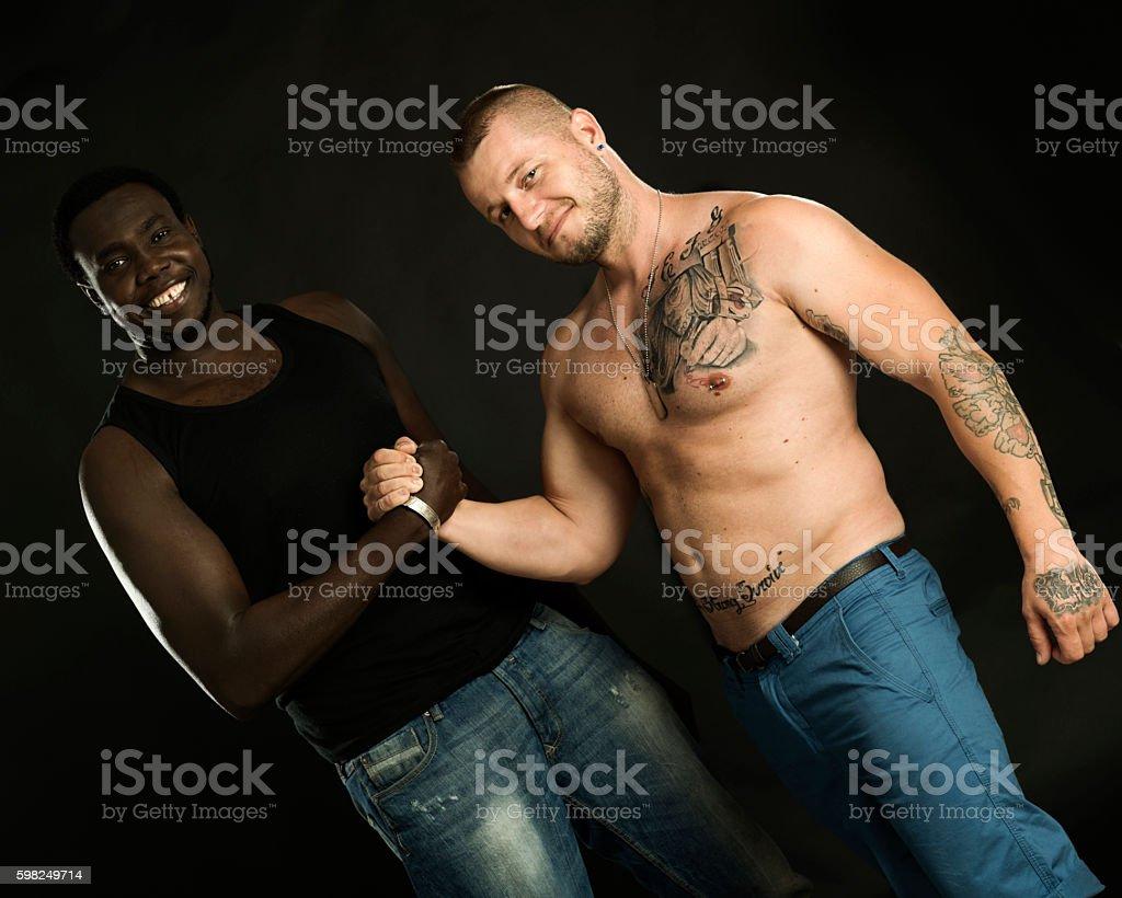 Two men make handshake stock photo