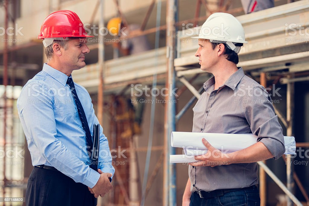 Two men on a construction site stock photo