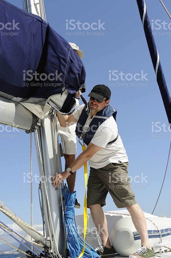 Two Men on a Sailboat royalty-free stock photo