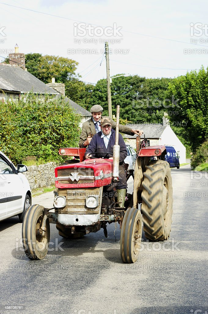 Two Men On An Old Massey Ferguson 135 Tractor stock photo