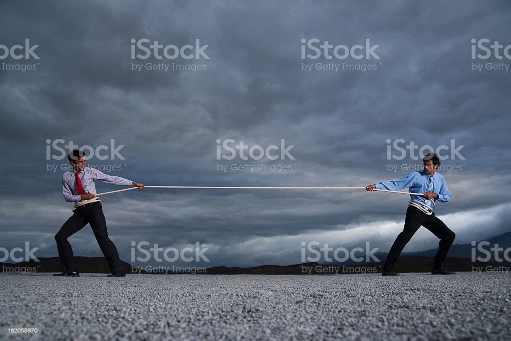 Two men outdoors in tug of war stock photo