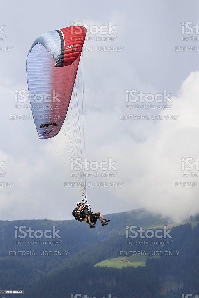 Two men paragliding over Zillertaler alps, Zell am Ziller, Austria stock photo