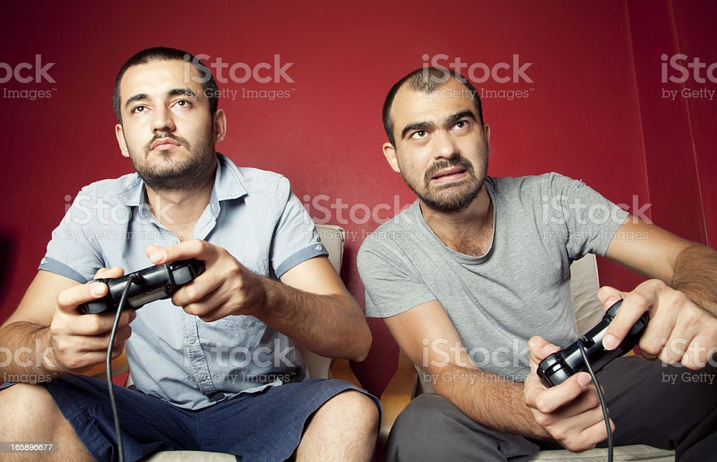 Two men playing a video game together stock photo