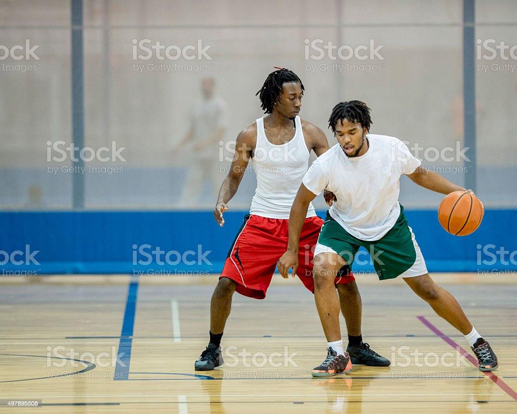 Two Men Playing Basketball stock photo