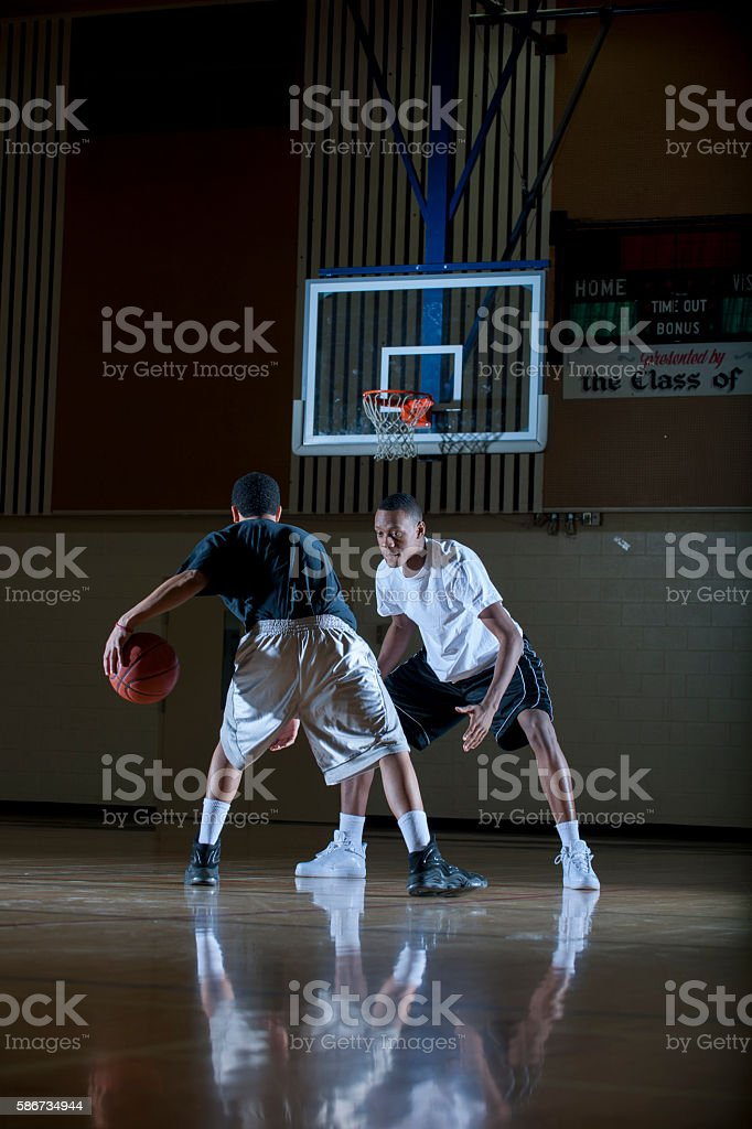 Two Men Playing Basketball stock photo