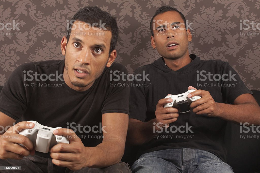 Two Men Playing Computer Games royalty-free stock photo