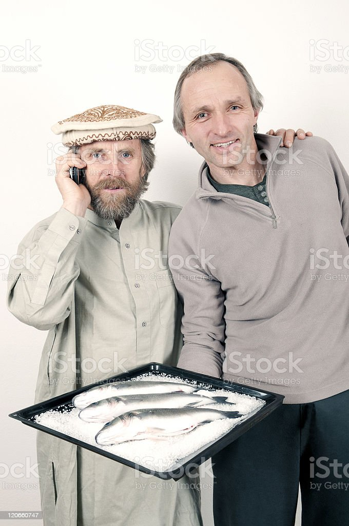 Two Men Posing with a Platter of Fish royalty-free stock photo