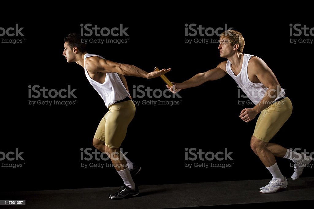 Two men running while the other passes a baton  stock photo