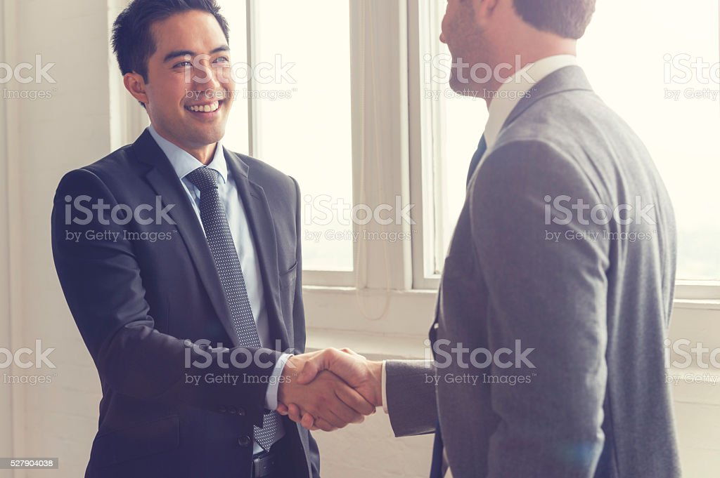 Two men shaking hands. stock photo