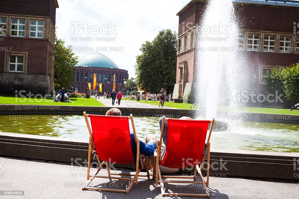 Two men sitting in sunshine at Kunstpalast stock photo