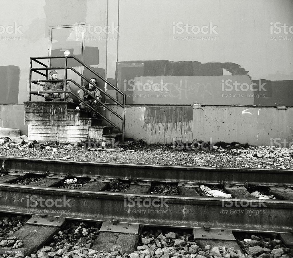 Two Men Sitting on Old Stairs royalty-free stock photo