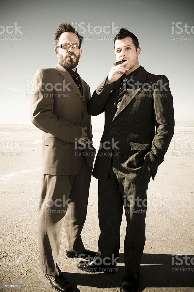 Two men smoking cigars stock photo