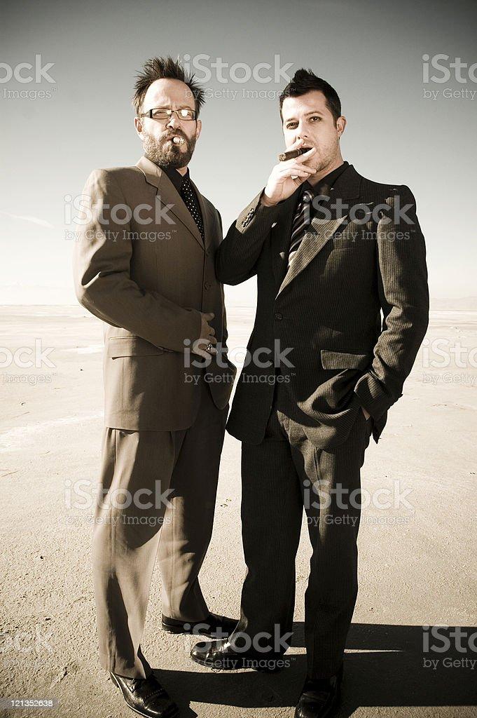 Two men smoking cigars stock photo